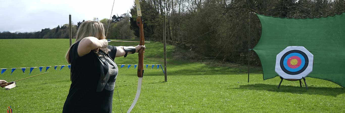 Woman at Hen Party in Edinburgh ready to make her shot in Archery with Great Away Days