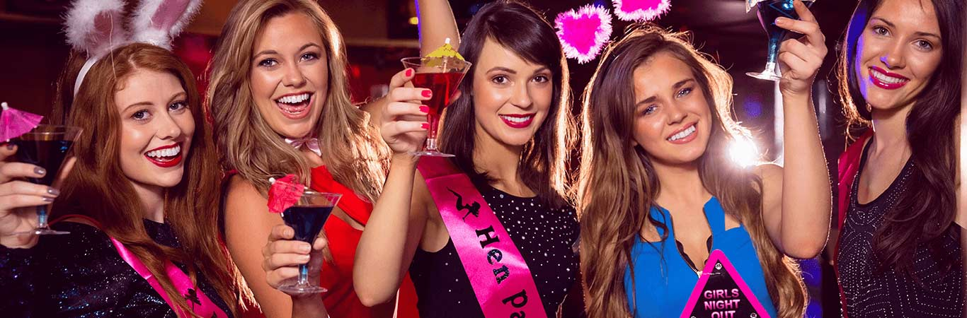 Girls partying in a night club in Edinburgh on their hen weekend with Great Away Days