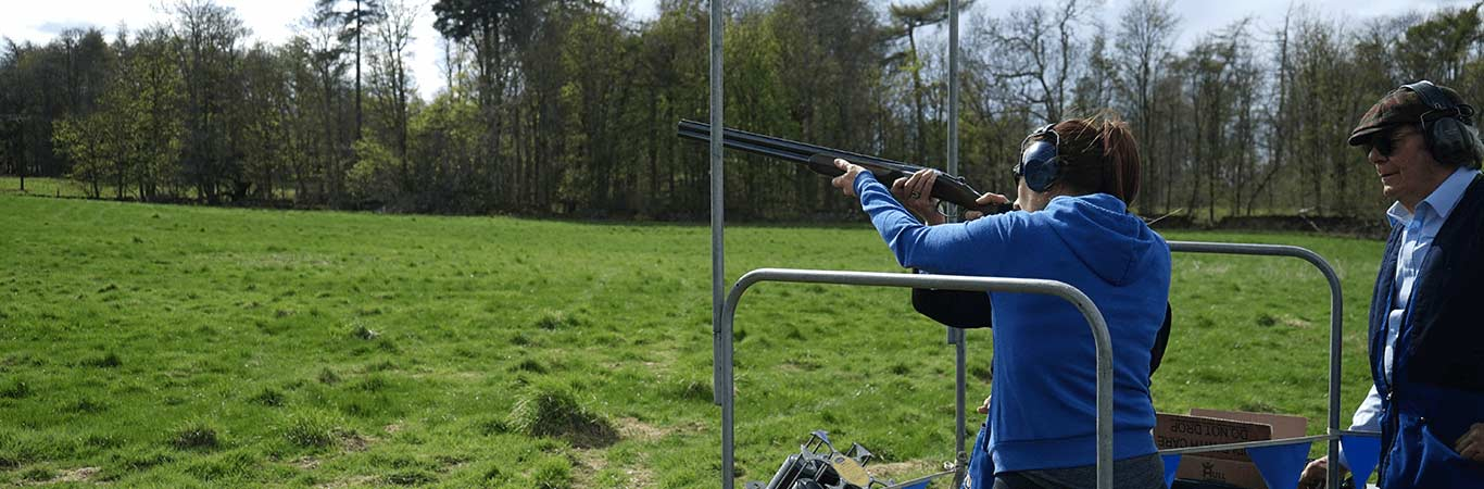 Female on Team Away Days getting ready to take a shot at Clay Pigeon Shooting in Edinburgh with Great Away Days