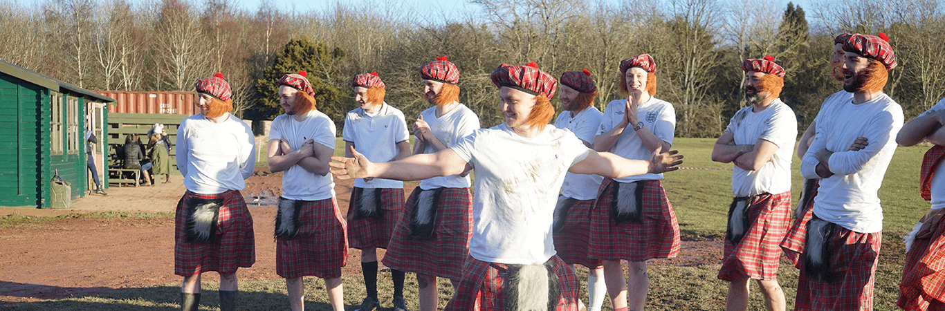Stag Group celebrating during a Mini Highland Games in Edinburgh all with kilts on