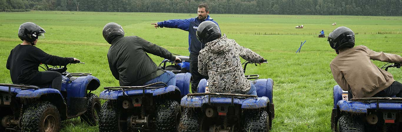 Great Away Days Instructor showing a small team what to do on their Quad Biking course in Edinburgh