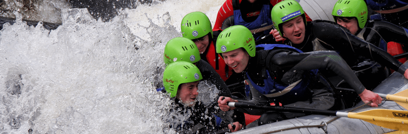 Girls on a Hen Party getting soaked during white water rafting in Perthshire with Great Away Days