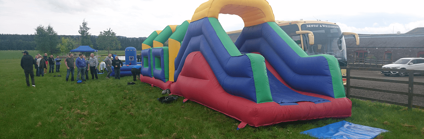 Team getting ready to take on giant inflatable assault course on their team away day in Edinburgh with Great Away Days