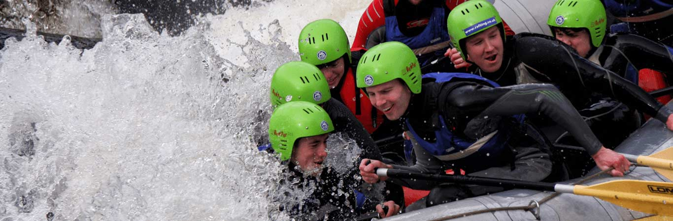 Stag Party getting soaked whilst white water rafting in Perthshire with Great Away Days