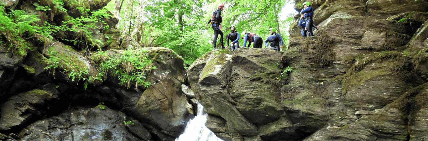 Hen Group getting ready to jump into a pool of water whilst canyoning with great away days